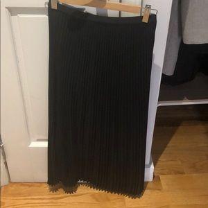 Aritzia black mid length pleated skirt